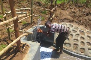 The Water Project: Tumaini Community, Ndombi Spring -  Splash