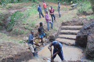 The Water Project: Mubinga Community, Mulutondo Spring -  Community Helps With Foundation