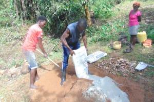 The Water Project: Mubinga Community, Mulutondo Spring -  Mixing Cement
