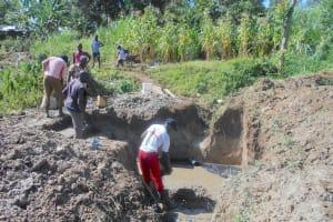 The Water Project: Kalenda B Community, Lumbasi Spring -  Community Helps Cast The Foundation