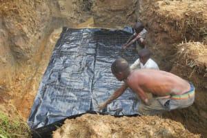 The Water Project: Tumaini Community, Ndombi Spring -  Foundation Laying