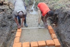 The Water Project: Emurumba Community, Makokha Spring -  Measuring Bricksetting