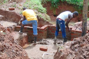 The Water Project: Imusutsu Community, Ikosangwa Spring -  Wall Construction