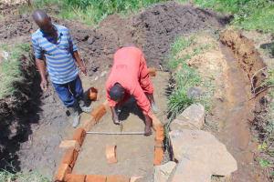 The Water Project: Mukangu Community, Metah Spring -  Brick Setting