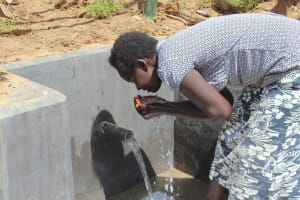 The Water Project: Tumaini Community, Ndombi Spring -  Getting A Fresh Drink