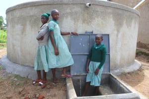 The Water Project: Bugute Lutheran Primary School -  Girls With Rain Tank