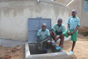 The Water Project: Bugute Lutheran Primary School -  Boys With Rain Tank