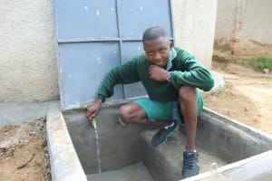 The Water Project: Bugute Lutheran Primary School -  Posing With Flowing Water