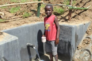 The Water Project: Tumaini Community, Ndombi Spring -  Fresh Drink In Hand