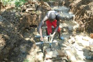 The Water Project: Namarambi Community, Iddi Spring -  Pipe Setting