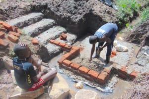 The Water Project: Mubinga Community, Mulutondo Spring -  Brick Setting