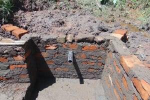 The Water Project: Maondo Community, Ambundo Spring -  Headwall Construction