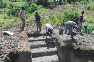 The Water Project: Kalenda B Community, Lumbasi Spring -  Setting Stair Foundatin
