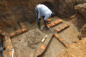 The Water Project: Tumaini Community, Ndombi Spring -  Brick Setting