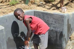 The Water Project: Tumaini Community, Ndombi Spring -  Enjoying The Spring Water