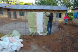 The Water Project:  Attaching Sugar Sacks To Wire