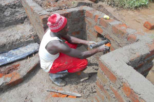 The Water Project: Kalenda A Community, Webo Simali Spring -  Setting The Discharge Pipe