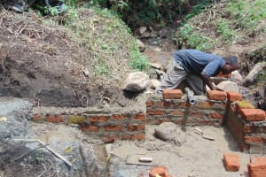 The Water Project: Mubinga Community, Mulutondo Spring -  Wall Construction