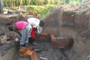 The Water Project: Kalenda B Community, Lumbasi Spring -  Wall Construction