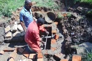 The Water Project: Mukangu Community, Metah Spring -  Pipe Setting