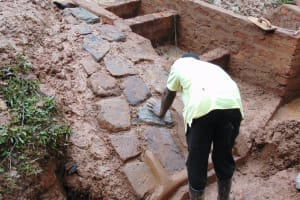 The Water Project: Kitulu Community, Kiduve Spring -  Stone Pitching
