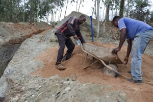 The Water Project: Ngitini Community D -  Dumping Sand For Mixing With Cement