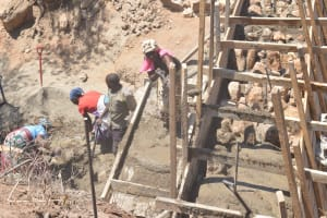 The Water Project: Wamwathi Community -  Adding Rocks To The Wall