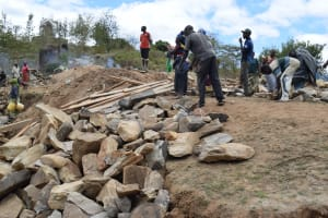 The Water Project: Kyamwao Community -  Carrying Rocks