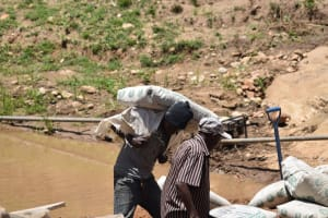 The Water Project: Kyamwao Community -  Hauling Cement