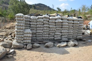 The Water Project: Kyamwao Community -  Stacks Of Cement Bags