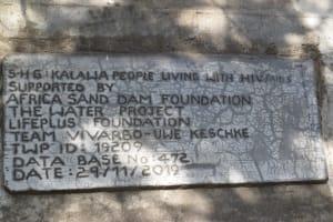 The Water Project: Kaketi Community -  Sand Dam Plaque
