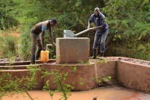 The Water Project: Ngitini Community E -  Collecting Water