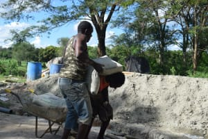The Water Project: Ngitini Community E -  Hauling Cement