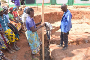 The Water Project: Kyandoa Primary School -  Artisan Works With Community Members