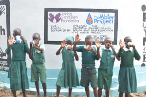 The Water Project: Kangutha Primary School -  Drinking Water From The Tank