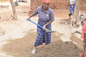 The Water Project: Kangutha Primary School -  Mixing Cement For The Walls