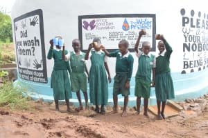 The Water Project: Kangutha Primary School -  Raising Glasses Of Water From The Tank