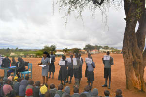The Water Project: Kithoni Primary School -  Students Hold Up Posters