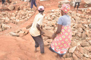 The Water Project: Nguluma Primary School -  Carrying Rocks