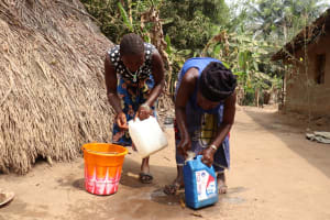 The Water Project: Kamayea, Susu Community & Church -  Cleaning Container Demonstration