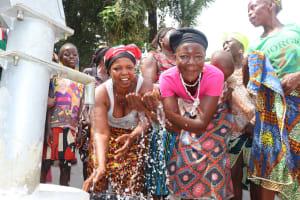 The Water Project: Kamayea, Susu Community & Church -  Splashing Water At The Well