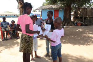The Water Project: Lungi, Tintafor, St. Lucia Well -  Kids Arrange Disease Transmission Posters