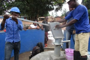 The Water Project: Lungi, Tintafor, St. Lucia Well -  Pumping Water