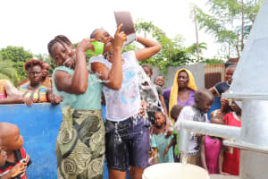The Water Project: Lungi, Tintafor, St. Lucia Well -  Splashing Clean Water