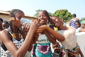 The Water Project: Lungi, 25 Maylie Lane -  Children Drink Water From The Well
