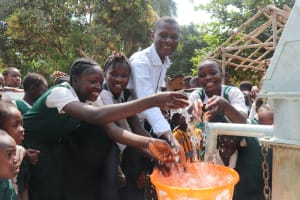 The Water Project: Lungi, Mamankie, DEC Mamankie Primary School -  Head Teacher And Students Splashing Water