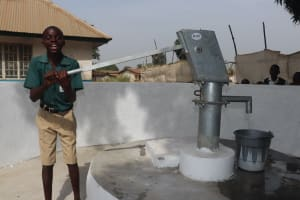 The Water Project: Lungi, Kasongha, DEC Kasongha Primary School -  Happy Student Fetches Water
