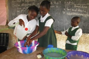 The Water Project: Lungi, Kasongha, DEC Kasongha Primary School -  Students Demonstrating Hand Washing Method With Tippy Tap