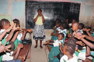 The Water Project: Lungi, Kasongha, DEC Kasongha Primary School -  Teacher Shows Handwashing