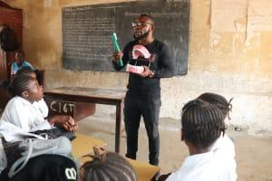 The Water Project: Lungi, Kasongha, DEC Kasongha Primary School -  Teacher Shows Toothbrushing